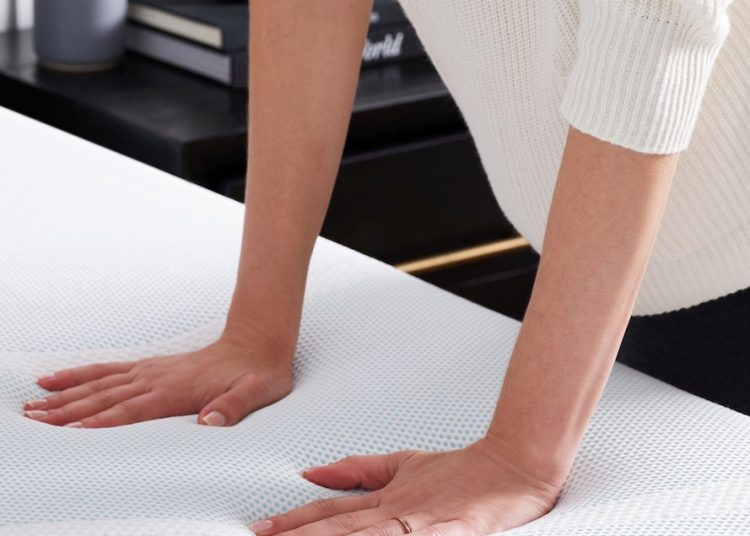 Girl Checking Firmness of the Mattress